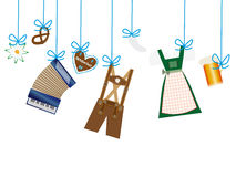 Octoberfest background, lederhosen, dirndl, edelweiss, pretzel hanging on blue line Stock Photography