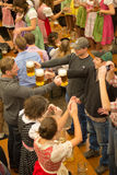 Octoberfest beer drinkers. Young men drinking beer on Octoberfest in Munich Stock Photos