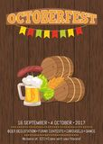 Octoberfest Poster with Wooden Background and Text. Vector illustration of wooden casks, beer mug, fried sausage, green hop and wheat ear Stock Photography