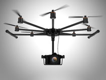 Octocopter carrying DSLR camera  on gray background Royalty Free Stock Photos