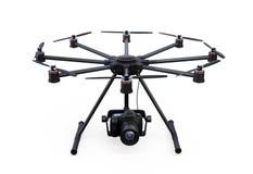 Octocopter com a câmera de DSLR isolada no fundo branco Fotos de Stock