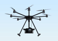 Octocopter with DSLR camera flying in the sky Stock Photography