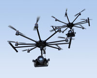 Octocopters flying in the sky Royalty Free Stock Images