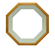 Octogonal wood picture frame. Picture frame in the shape of an octagon with a light green beveled mat, isolated with clipping path Stock Images