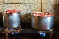 The octopus boiling inside a cauldron. For cooking the galician style Octopus called pulpo estilo feira Royalty Free Stock Image