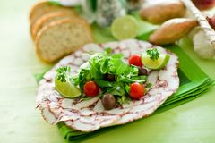 Octopus Carpaccio with mixed salad Royalty Free Stock Photography