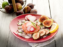 Octopus carpaccio over grapefruit Stock Images