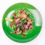 Octopus and chuka salad. Isolated on white background stock photos