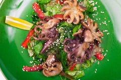 Octopus and chuka salad. Isolated on white background stock image