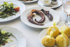 Octopus in a Greek restaurant Stock Photo