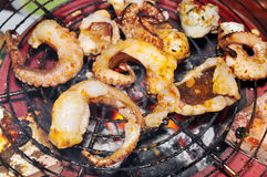 Octopus on the grill Stock Images