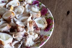 Octopus grill include egg cut into pieces for eat of seafood. Top view of octopus grill include egg cut into pieces for eat of seafood. The dish is placed on Royalty Free Stock Photo