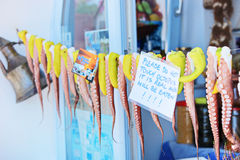Octopus hanging on a line in front of a greek shop Royalty Free Stock Image