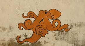 Octopus illustration on wall Stock Image