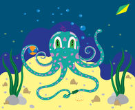 The octopus the kid plays in sand. Stock Photography
