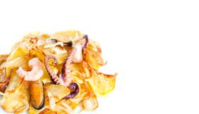 Octopus, mussel and shrimp with french fries. Seafood dish over fried potatoes. white background. copy space. Closeup Stock Photos