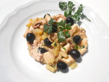 Octopus with potatoes. Tasty fish dish with olives Royalty Free Stock Photography