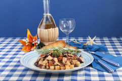 Octopus with potatoes and olives to the piñata Stock Image