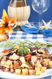 Octopus with potatoes and olives to the piñata Stock Images