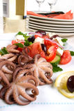 Octopus in red wine Stock Photo