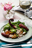 Octopus salad with arugula salad mix and wine. Octopus salad with arugula salad mix and a full wine in a restaurant Stock Photos