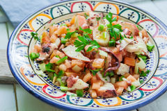 Octopus salad on bowl Stock Photos