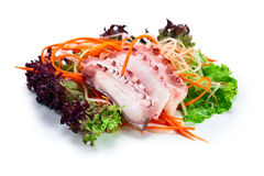Octopus with salad Royalty Free Stock Photo