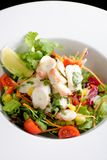 Octopus salad with lemon slice lettuce and potatoes Stock Image