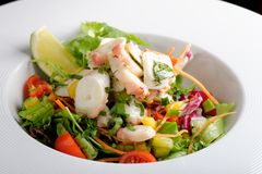 Octopus salad with lemon slice lettuce and potatoes Royalty Free Stock Images