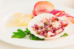 Octopus salad served with cheese and prosciutto on the side Royalty Free Stock Photos