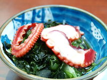 Octopus sashimi. In the blue blow, traditional Japanese dishes Royalty Free Stock Photo