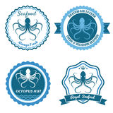 Octopus sea food logo or badge set Stock Image