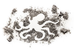 Octopus silhouette drawing design made in pile of ash as a seafood, grill, monster, sea and ocean animal life concept royalty free stock photo