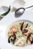 Octopus soup with mussels Stock Photography