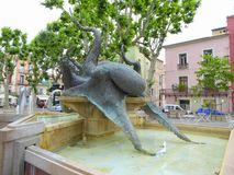 Octopus statue in town square. The bronze statue of an octopus in the main square in the city of Sete in France stock photos