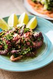 Octopus tentacles pan fried with herb dressing Royalty Free Stock Photo