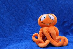Octopus toy on blue background Royalty Free Stock Photography