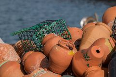 Octopus traps. View of a pile of ceramic octopus traps Stock Photos
