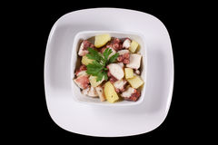 Octopus With Potatoes Served In A White Dish Royalty Free Stock Photo