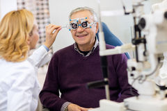 Ocular specialists work with patient on eye clinic Stock Photos