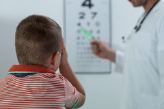 Oculist examining boy vision Stock Photo