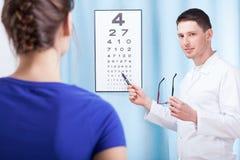 Oculist examining patient Stock Photo