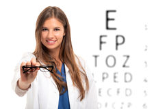 Oculist holding a pair of eyeglasses Stock Photography