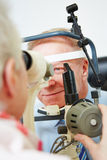 Oculist measuring cornea of elderly Stock Images