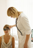 Oculist and patient Royalty Free Stock Photos