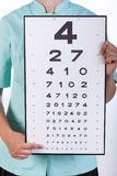 Oculist with a Snellen chart Royalty Free Stock Photos