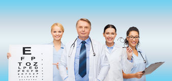 Oculisti ed infermieri sorridenti Fotografie Stock