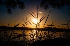 Ocultación de la puesta del sol imágenes de archivo libres de regalías