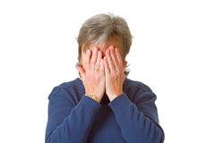 Ocultación de su cara en vergüenza Foto de archivo libre de regalías