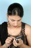 Ocupado con el móvil Fotografía de archivo